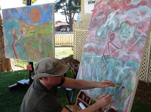 Reds Regan painting outside