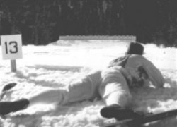 biathlon athlete laying down