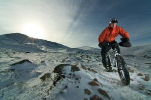 snowbiking in the mountains